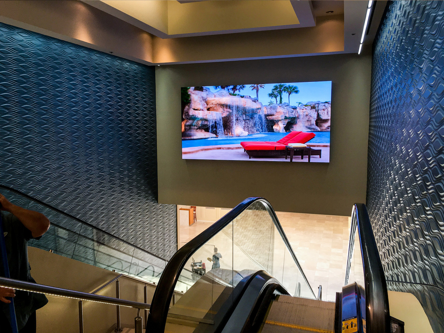 video wall above escalator